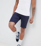 Shorts vaqueros en azul marino de corte Slim de ASOS DESIGN Tall